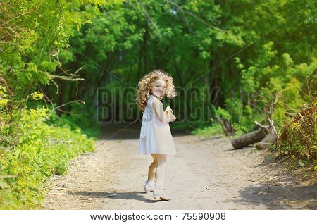 Cheerful Playful Curly Little Girl In The Forest, Sunny Summer Day