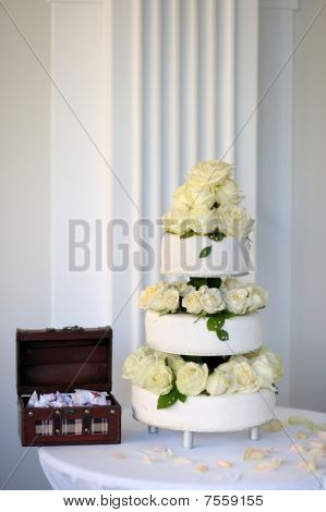 Big Wedding Cake And A Box Full Of Sweets