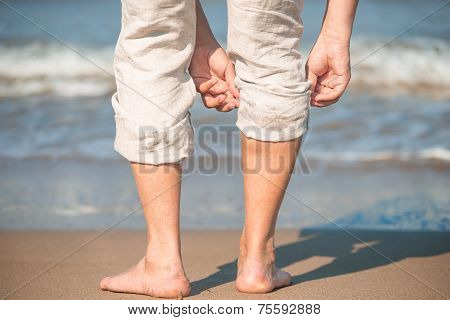Male Tucks Linen Trousers On The Beach