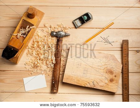joinery tools on wood table background with business card