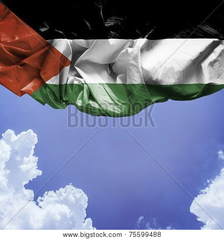 Palestine waving flag on a beautiful day