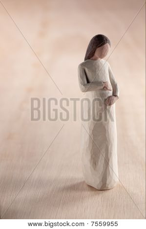 wooden figurine of pregnant woman