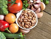 foto of pinto  - Pinto beans in a bowl and vegetables - JPG