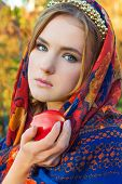 picture of tooth-fairy  - beautiful young sweet girl in a headscarf with the rim on the head with a red Apple in his hand - JPG