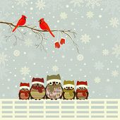 stock photo of bird fence  - Christmas card a branch with red birds and family of owls on fence - JPG