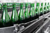 pic of liquor bottle  - empty liquor bottles on the conveyor belt - JPG