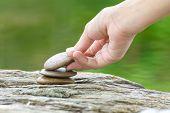 picture of zen  - Zen concept Hand put stone building a pile of zen stones - JPG