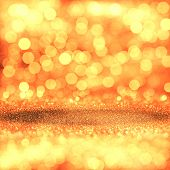 image of glitz  - Golden festive glitter background with defocused lights - JPG