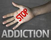 stock photo of addicted  - Educational and Creative composition with the message Stop Addiction on the blackboard - JPG