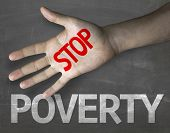 stock photo of poverty  - Educational and Creative composition with the message Stop Poverty on the blackboard  - JPG
