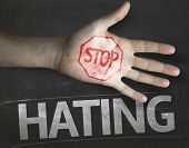 pic of stop hate  - Educational and Creative composition with the message Stop Hating on the blackboard - JPG