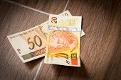 foto of brazilian money  - 20 and 50 Reais on the floor  - JPG