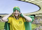 foto of brasilia  - Woman holds a brazilian flag on the stadium - JPG