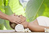 foto of massage therapy  - portrait of young beautiful woman in spa environment - JPG