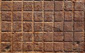 image of manhole  - Detail of the pattern from a rusty manhole cover - JPG
