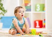 stock photo of indoor games  - kid boy playing with block toys indoor - JPG