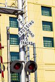 image of railroad-sign  - railroad crossing sign with blue sky in San Diego - JPG