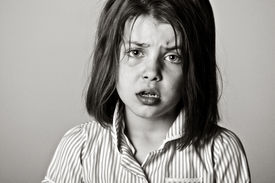 stock photo of school bullying  - Powerful Black and White Shot of a Young Schoolgirl - JPG