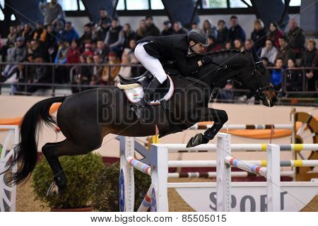 KAPOSVAR, HUNGARY - MARCH 15: Balazs Varga jumps with his horse (JLO) on the Masters Tournament International Jumping Competition, March 15, 2015 in Kaposvar, Hungary