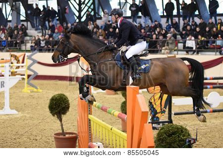 KAPOSVAR, HUNGARY - MARCH 15: Krisztian Buza jumps with his horse (PM Fortuna) on the Masters Tournament International Jumping Competition, March 15, 2015 in Kaposvar, Hungary