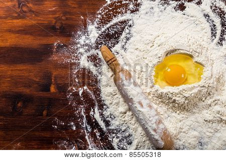 Flour, egg and rolling pin with copy space