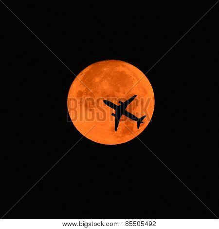 Airplane Across A Full Moon