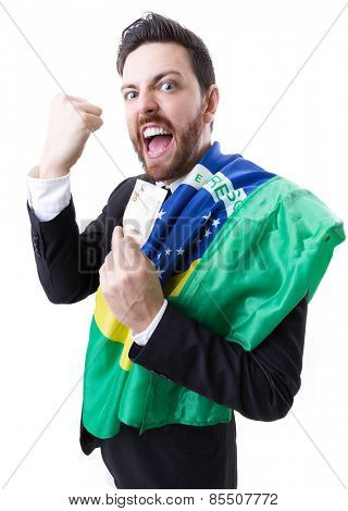 Businessman celebrating with the Brazilian flag on white background