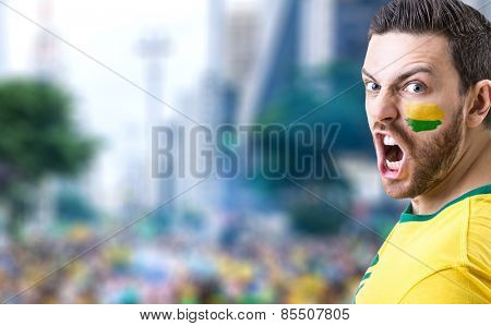 Man holding the Brazilian flag in Sao Paulo, Brazil