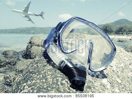 Snorkeling set on Karon beach of Phuket island, Thailand. Washed out look