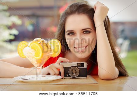 Happy Young Woman with Vintage Camera and Summer Dessert