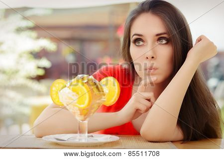 Young Woman Deciding to Eat a Summer Desert