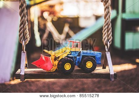Excavator toy on a swing
