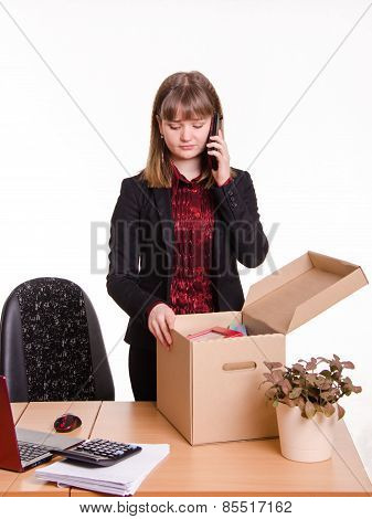 Girl In Office Examines Personal Things And Calling On Phone
