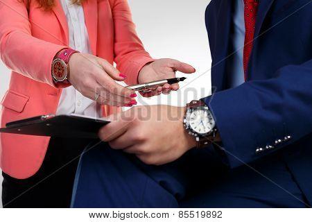 Secretary in a pink jacket takes a pen boss.