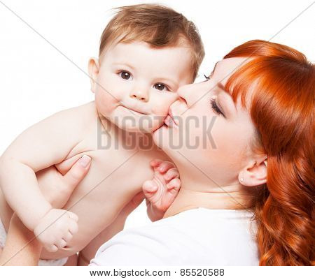 Mother with baby isolated on white. kissing