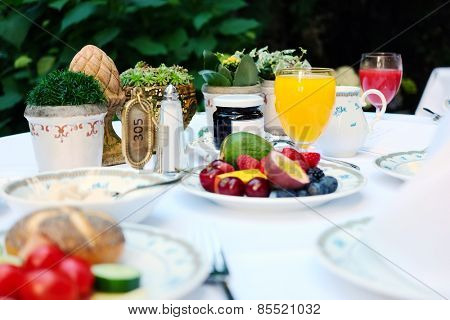 Outdoor continental breakfast at hotel. Shallow depth of field. No brandnames or copyright objects.