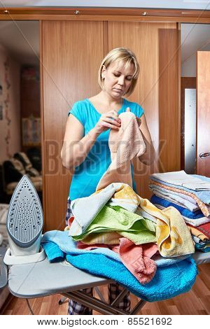 Woman Housewife From Ironing Board
