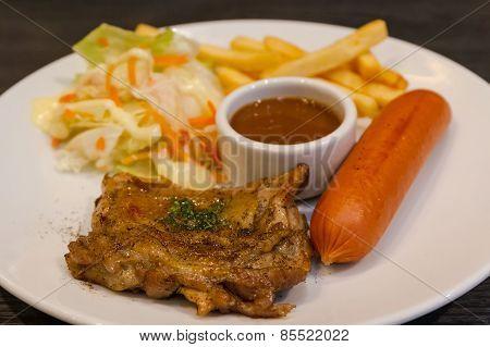 Steak Chicken And Hotdog With Salad .