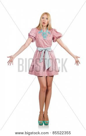 Woman in pink doll dress isolated on white