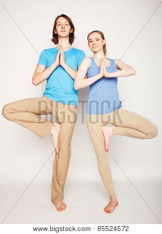 Young couple in yoga pose, happy family