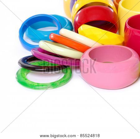 Pile of round modern colorful plastic bangles