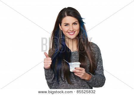 Healthy woman eating yoghurt