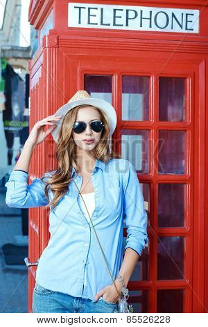 Beautiful young woman walking in the city. Europe, England. Vacation, tourist trip.