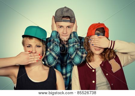 Group of young modern people posing together with fun. Studio shot.