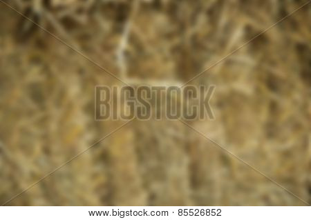 Intentional blurred background scene of straw or hay bales stacked