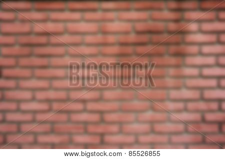 Intentional blurred background scene of a red brick wall