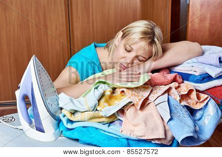 Tired Housewife Sleeping On An Ironing Board