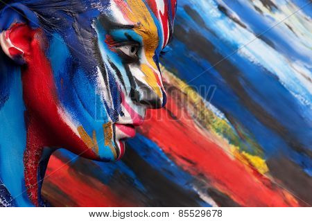 Colorful body art on the body of the girl. Beautiful paint on the body.