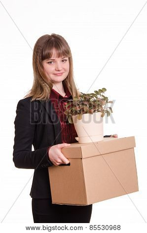 Portrait Of A Girl With Big Box And Potted Plant In Hands