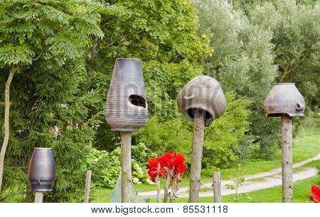 Old Black Pitchers Jug Jar  In Summer Garden